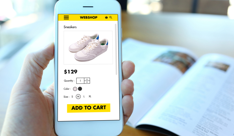 Hand,Holding,Smartphone,With,Choose,Shoes,On,Ecommerce,Website